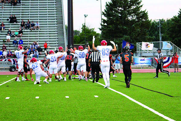 The LHS football team celebrates after scoring a touchdown during the annual Presidents' Bowl game.