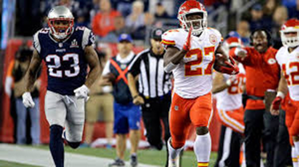 Hunt runs down the sideline during week one's game: Chiefs versus the Patriots.