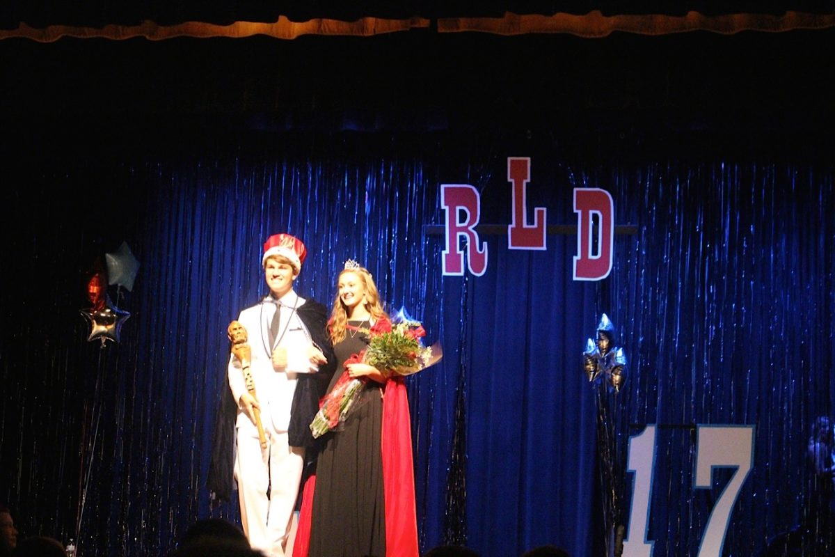 Tim+White+and+Anna+Robinson+winning+homecoming+king+and+queen+at+LHS.