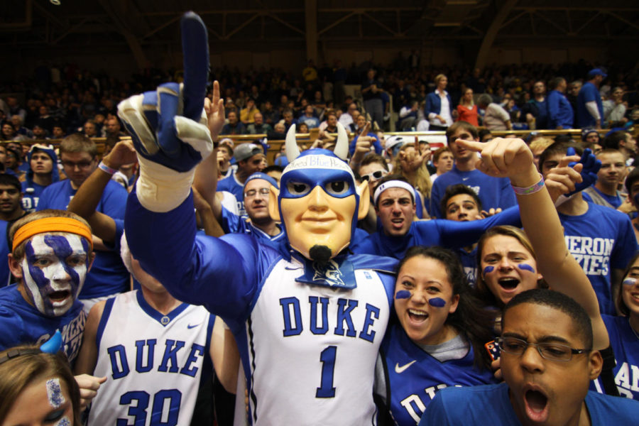 The+%22Cameron+Crazies%22+cheer+on+the+Blue+Devils+on+the+path+to+the+NCAA+Tournament.