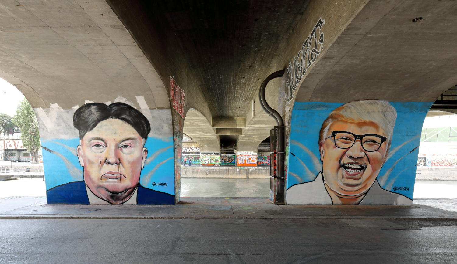 Graffiti of Kim Jong Un and Trump serves as political commentary.
