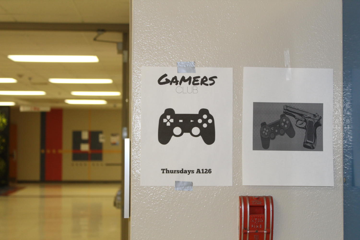 A friendly reminder from the Gamer's club at LHS next to a photo that characterizes how some feel about violent video games.