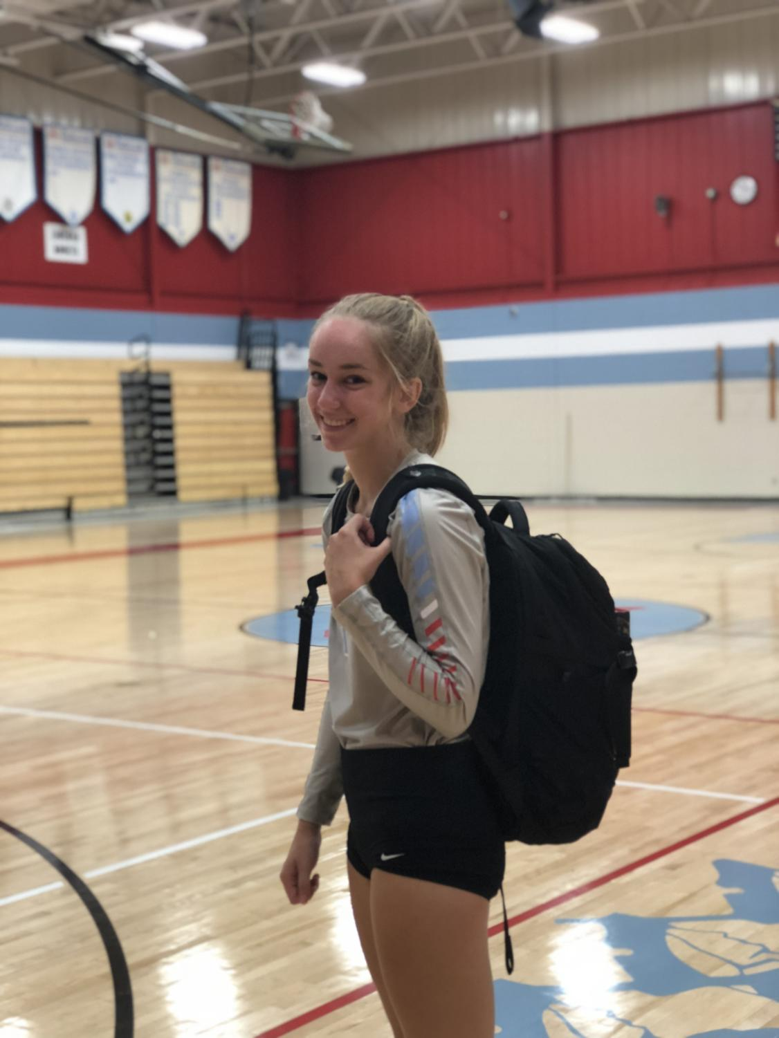 Sophomore Sara Croghan prepares for school and a volleyball game later that day.