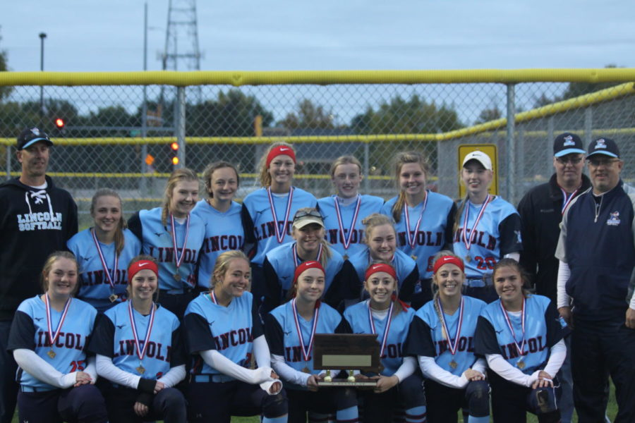 The LHS Softball team poses with their second place finisher plaque.