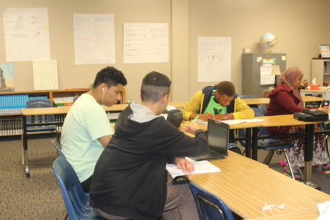 Kevin Alvarado and a peer work on an assignment for their World History class with Mrs. Griese.