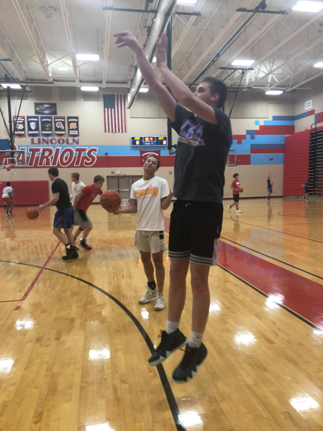 Sam Fawcett shooting hoops during open gym