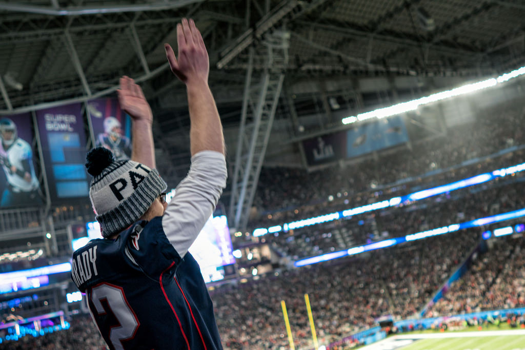 A Patriots fan celebrates a touchdown at the Super Bowl LII