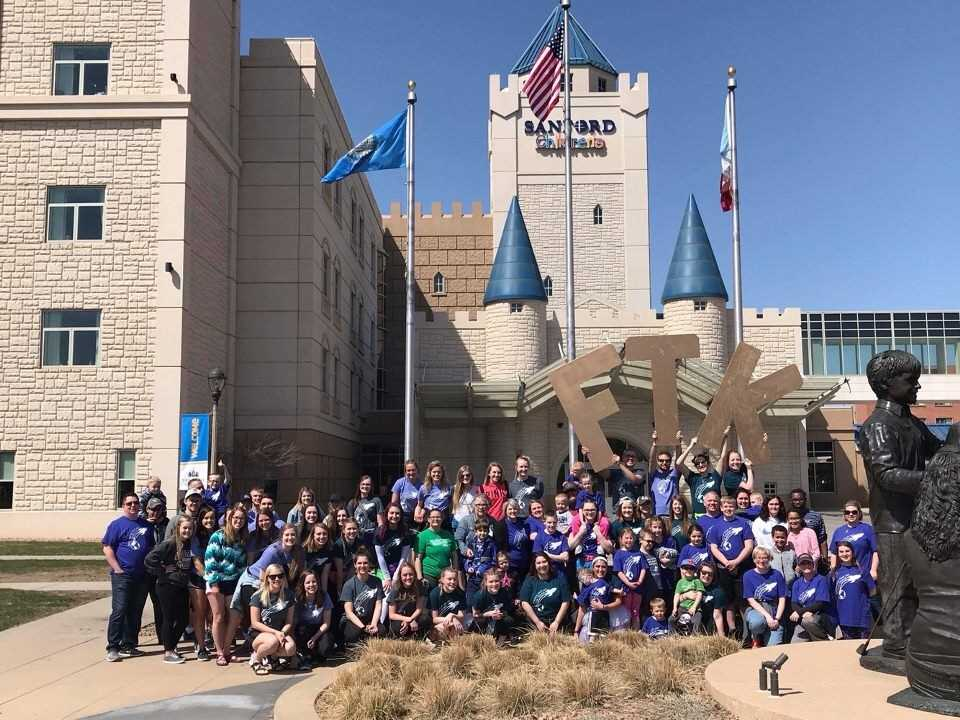 Participants of the Augiethon stand together in front of the Sanford Children's Hospital for the Children's Miracle Network fundraising event in April.