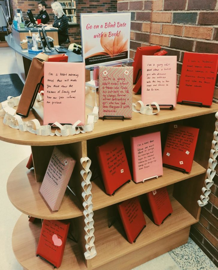 Displayed+at+the+Downtown+Library+is+an+entire+shelf+dedicated+to+Blind+Date+with+a+Book%2C+a+way+for+the+Siouxland+Libraries+to+encourage+people+to+read+and+explore+their+literature+options.