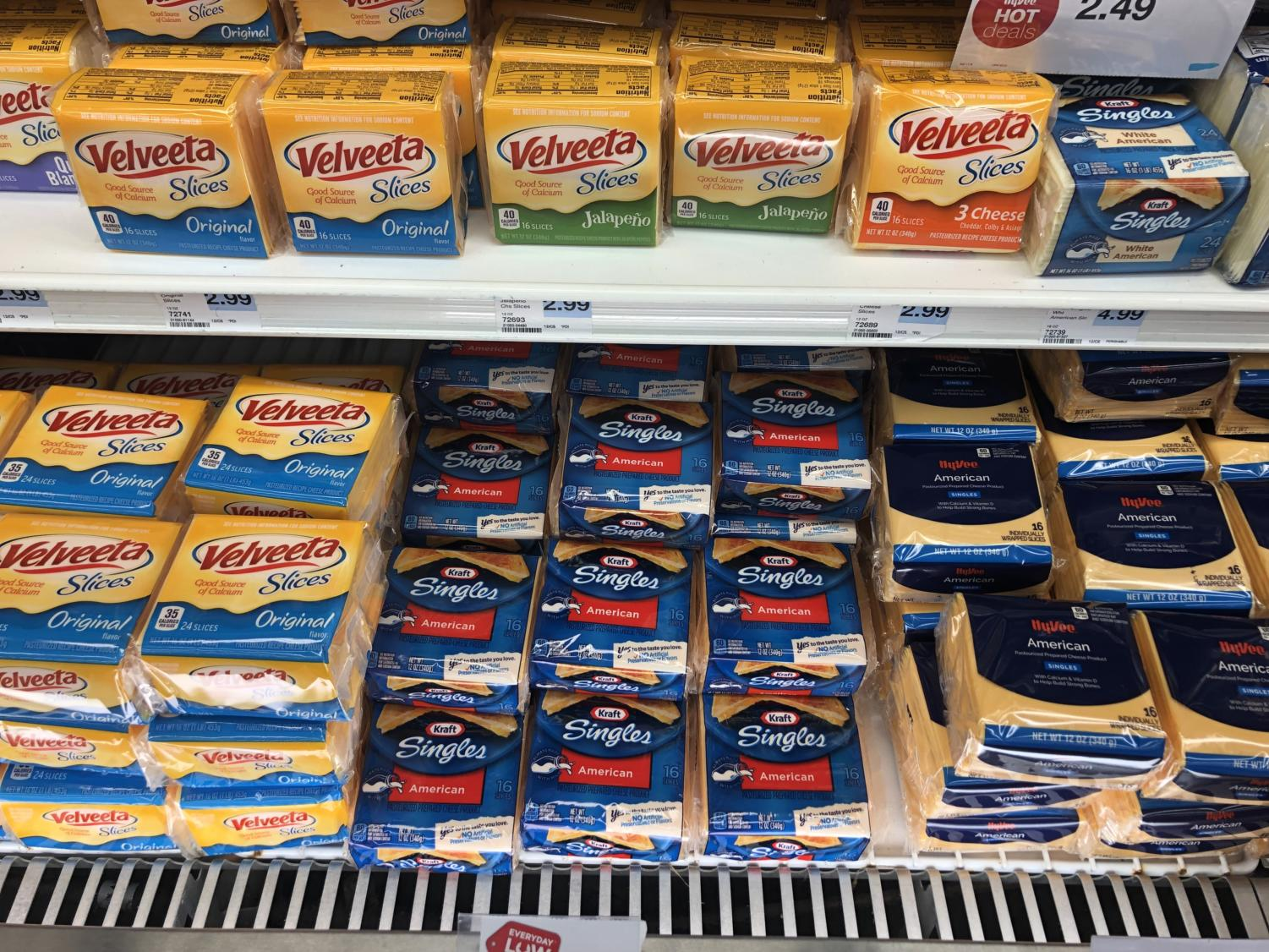 A wall of artificial cheese is a common sight at almost all grocery stores.