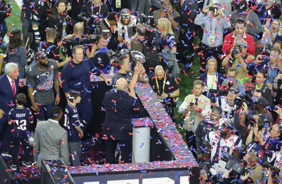 Brady hoists the Lombardi trophy after the Patriots' Super Bowl LI victory against the Atlanta Falcons.