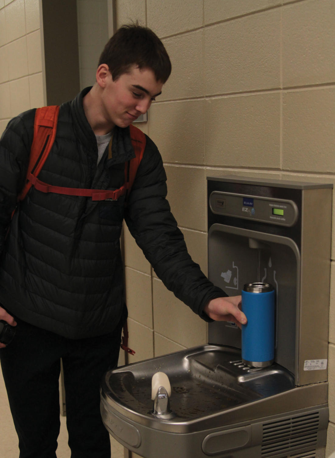 LHS freshman Charlie Mickelson takes a gamble and drinks the regular E-Wing water.