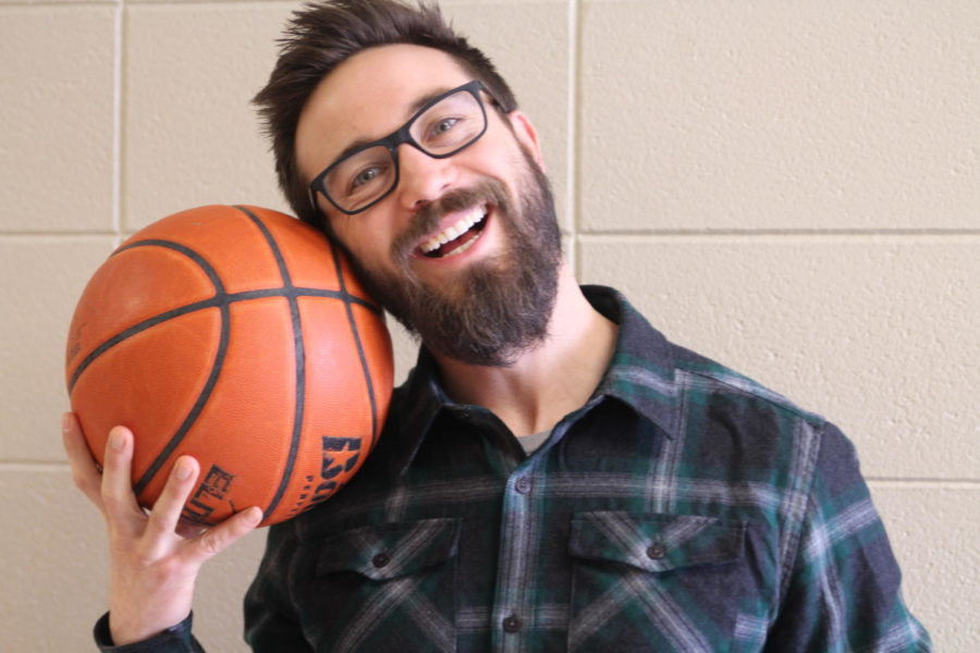 Travis Auckerman poses with a basketball to show his love for March Madness,