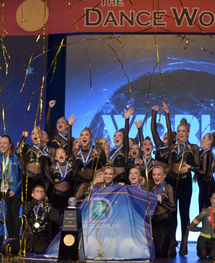 Champion Legacy after placing first in their pom routine at Worlds.
