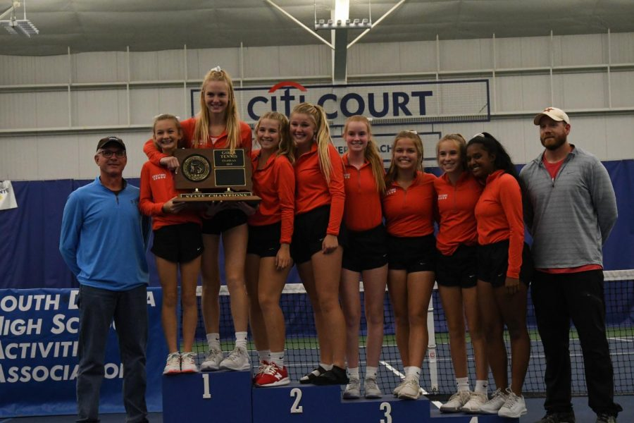 The LHS girls tennis team poses for pictures after claiming its fourth straight State title.