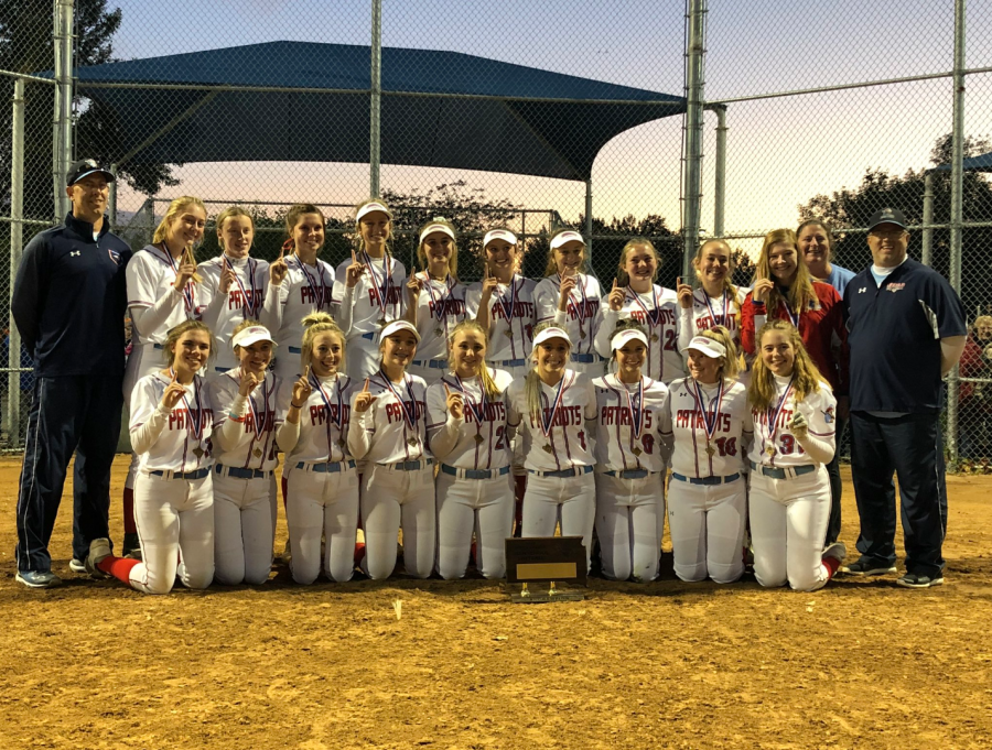 The LHS softball team poses for pictures after claiming its second State championship in SD history.