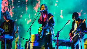 Tame Impala's lead vocalist, Kevin Parker, performing at the ACL Music Festival.