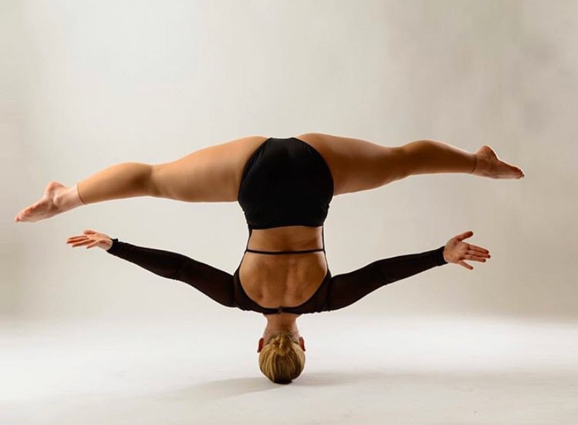 In+this+picture+Lange+showcases+her+signature+move%2C+spinning+on+her+head+while+in+the+splits.++