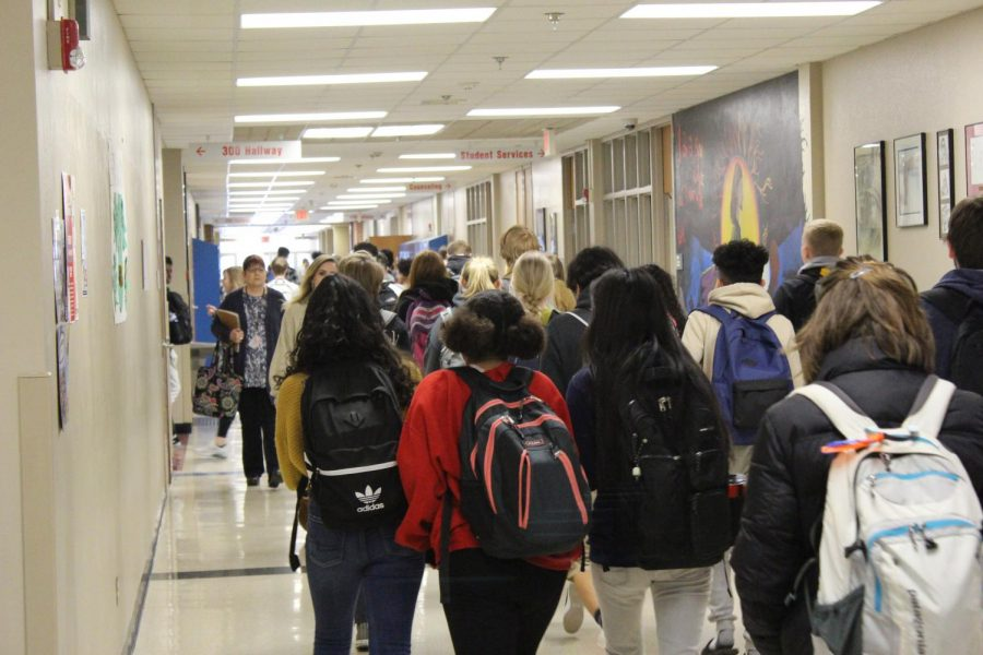 LHS students hustle to class after the music starts to play.
