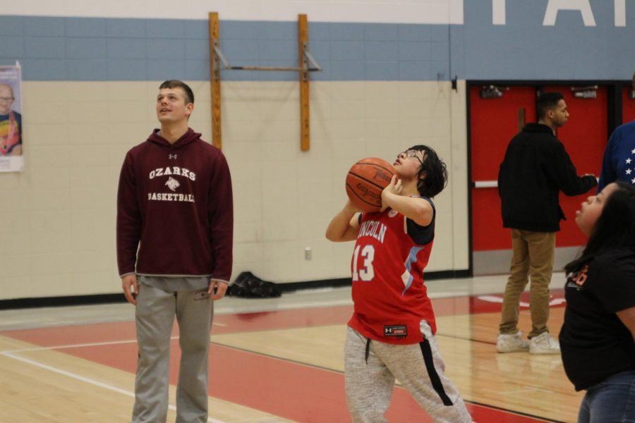 Dax Huezo-Vargas shoots with College of the Ozarks junior Trey Gibson on Tuesday, Mar. 10.