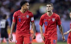 Young stars Christian Pulisic and Weston Mckennie walk off the field together after a CONCAF game