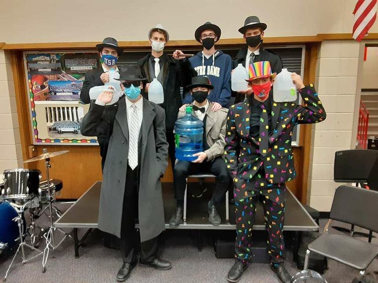 Members of the LHS Gallon Gang, Rogan Brison, Seth Vonbank, Andrew Martins, Joel Christensen, Erik Schultz, Cameron Rhode and Jackson Sluiter, dressed up as members of the Mafia for Halloween.