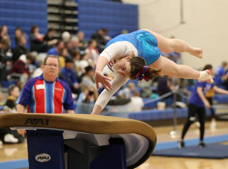 Lauren Holte performs the event of vault at a competition for the LHS Gymnastics team.
