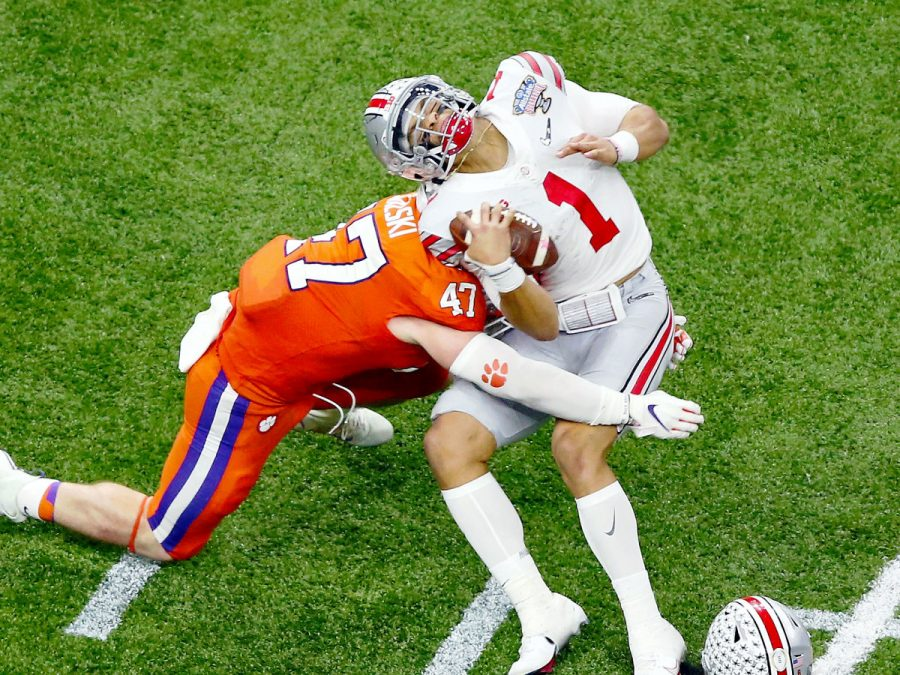 Justin+Fields+getting+cracked+in+the+back+by+Clemson+linebacker.