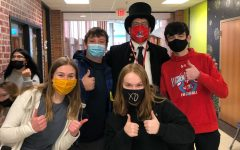"""The LHS Patriot Pride Committee is dedicated to the well-being of LHS and its students. Here, the organization's members are pictured with """"Abe Lincoln"""" during their annual Clash Of Coins fundraiser."""