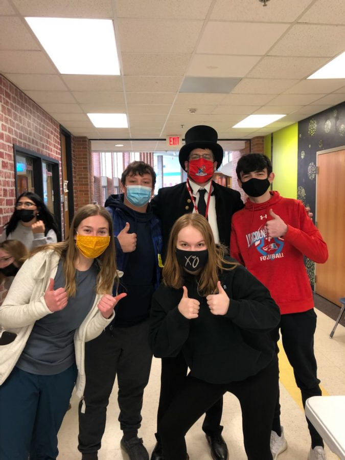 "The LHS Patriot Pride Committee is dedicated to the well-being of LHS and its students. Here, the organization's members are pictured with ""Abe Lincoln"" during their annual Clash Of Coins fundraiser."