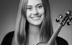 Elizabeth Jerstad poses with her violin, which she plans to continue playing at Stanford next year.