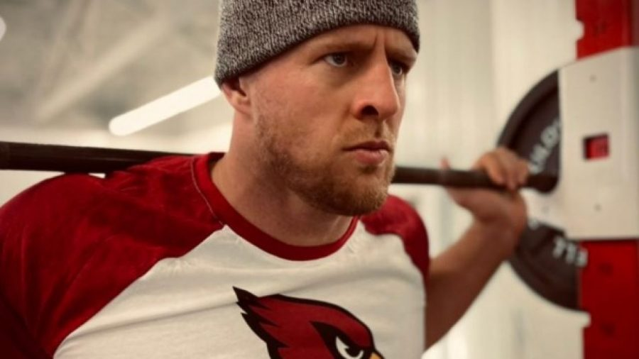 JJ Watt a 10 year veteran works out in a cardinals shirt a day after singing with Arizona.