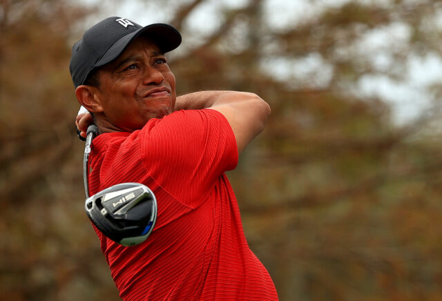 Tiger+Woods+watches+his+tee+shot+soar+down+the+course.