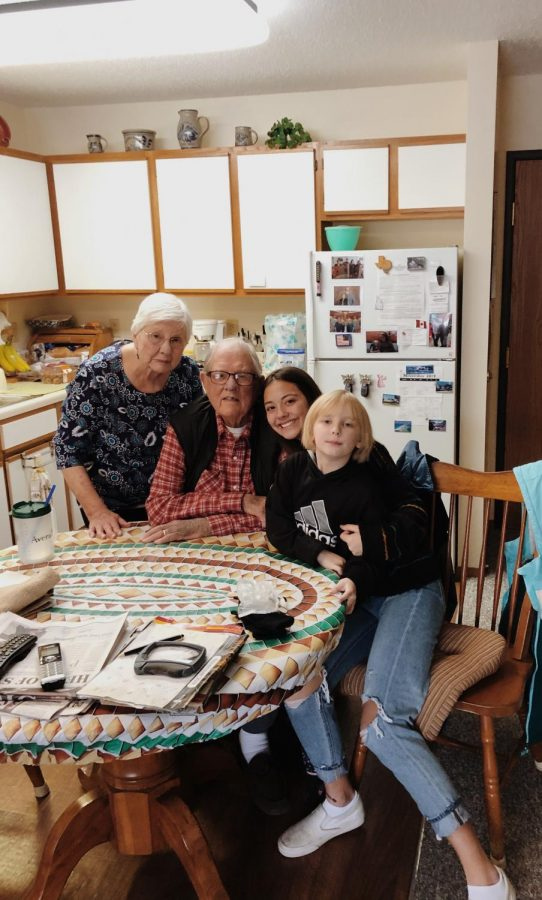 My great grandparents, my little sister and I sitting happily in their kitchen before they were separated.