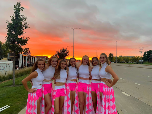 LHS color guard girls pose at Howard Wood Field ready for the Festival of the Bands competition this past Saturday.